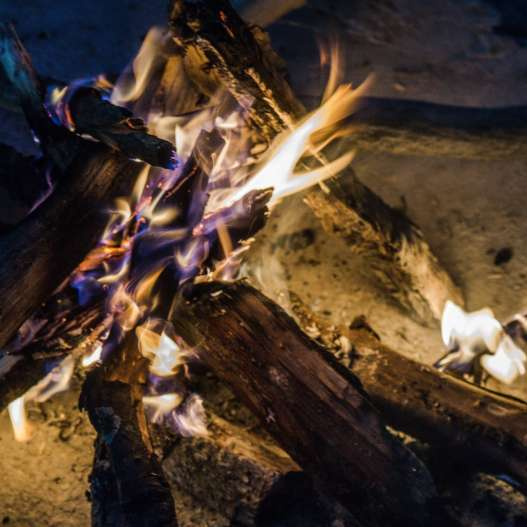 After the boat ride, take a moment to enjoy a small bonfire as you heat up.